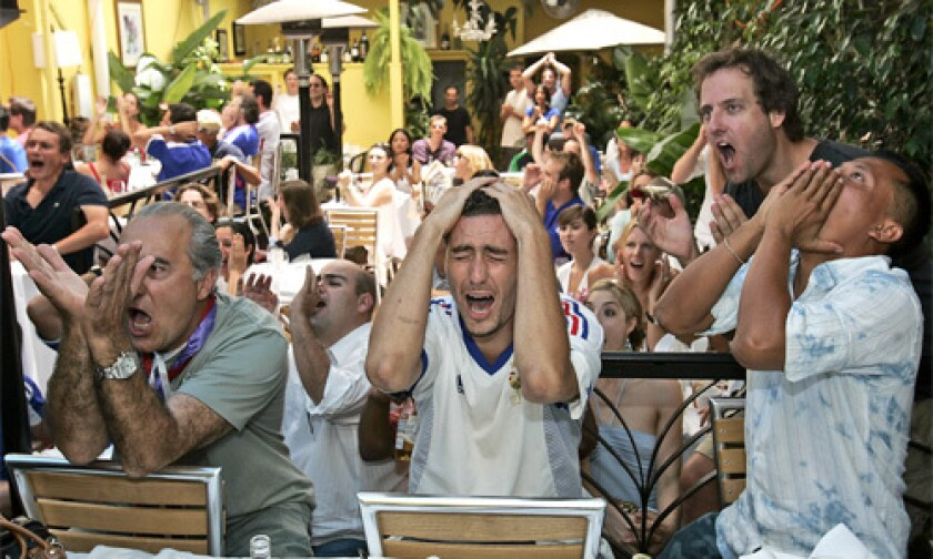 Fans react at the Cafe Marly on Melrose, as France misses a penalty kick en route to a loss to Italy in the 2006 FIFA World Cup finals.