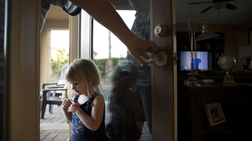 Doug Biggers, whose son, Landon, died of an opioid overdose in La Quinta, Calif., holds a door open for Landon's daughter, Aubrey.
