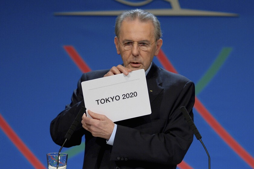 Jacques Rogge shows a card naming Tokyo as 2020 Summer Olympics host city.