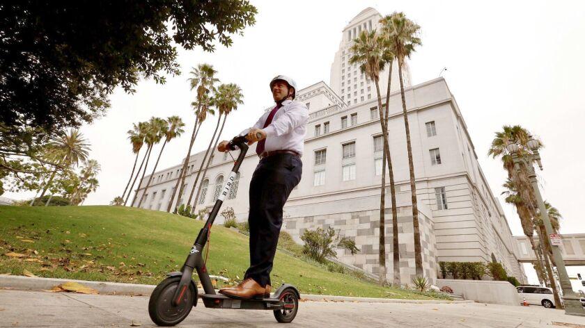 LOS ANGELES CA SEPTEMBER 4, 2018 -- City councilman Joe Buscaino rides a Bird scooter outside of ci