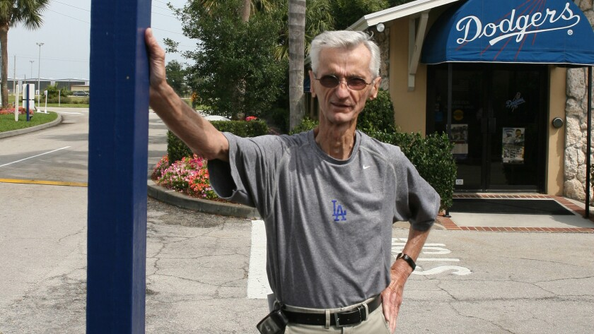 Billy DeLury stands at the corner of Jackie Robinson Avenue and Sandy Koufax Lane at Dodgertown in Vero Beach, Fla., on March 27, 2007.