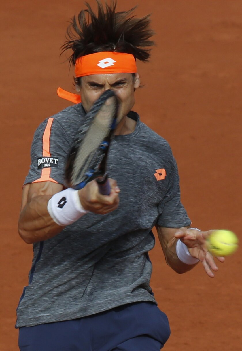 Spain's David Ferrer returns the ball to compatriot Feliciano Lopez during their third round match of the French Open tennis tournament at the Roland Garros stadium, Saturday, May 28, 2016 in Paris.  (AP Photo/Michel Euler)