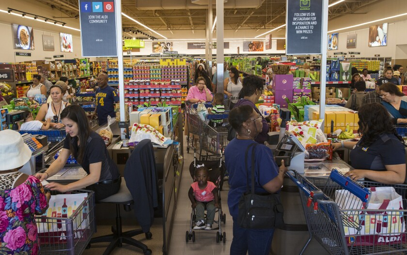 Shoppers wait in crowded lines to purchase groceries at the grand opening of Aldi on April 21 in Inglewood