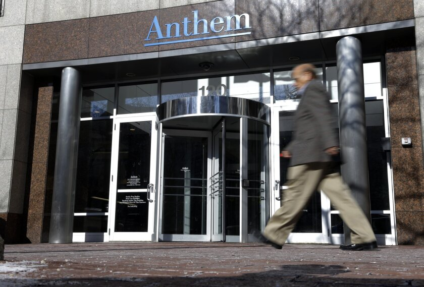 A man walks past health insurer Anthem's corporate headquarters in Indianapolis in 2015.