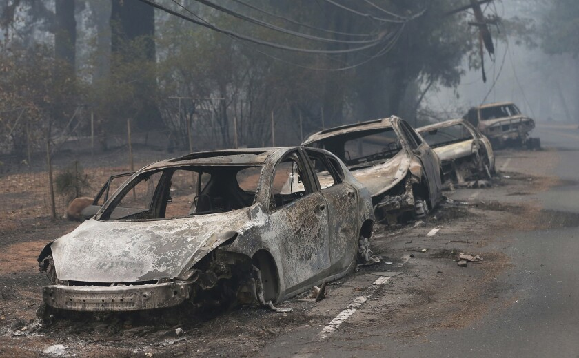 The burned out hulks of cars abandoned by their drivers sit along a road in Paradise, Calif., on April 18, 2018. The scale of disaster in the Camp Fire was unprecedented, but the scene of people fleeing wildfire was familiar, repeated numerous times over the past three years up and down California from Redding and Paradise to Santa Rosa, Ventura and Malibu.