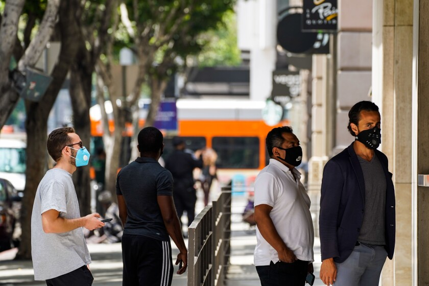 People wearing masks in downtown L.A. last month.