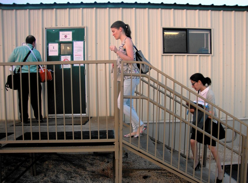 Marie Vincent, 29, a volunteer lawyer from San Francisco, enters the family detention center in Dilley, Texas, with Brian Hoffman and fellow volunteers.