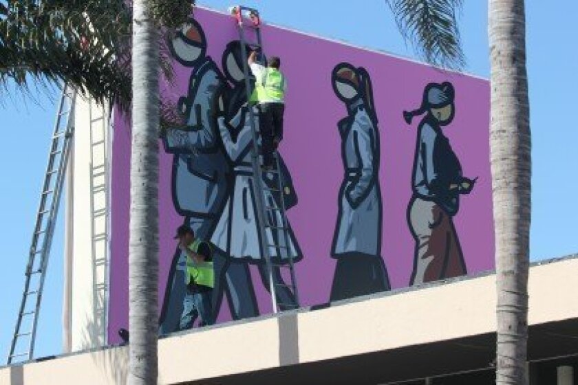 The two-sided mural, 'Walking in the City 1 and 2,' by Julian Opie is installed above la Jolla Independent BMW service in Bird Rock on April 20.