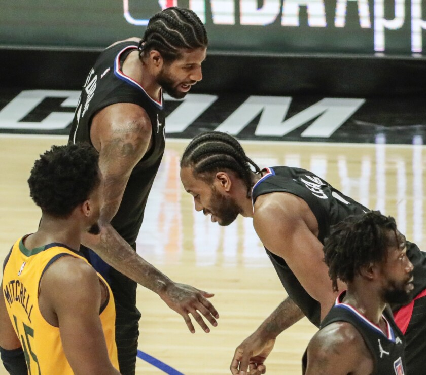 The Clippers' Kawhi Leonard is in pain as teammate Paul George checks on him during Game 4 against the Jazz.