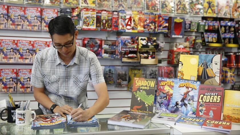 Gene Leun Yang signs comics at Flying Color Comics in Concord, Calif.