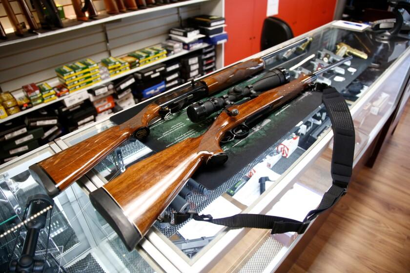A Remington 700 hunting rifle and a Remington 1100 shotgun are seen for sale at a North Carolina gun shop.