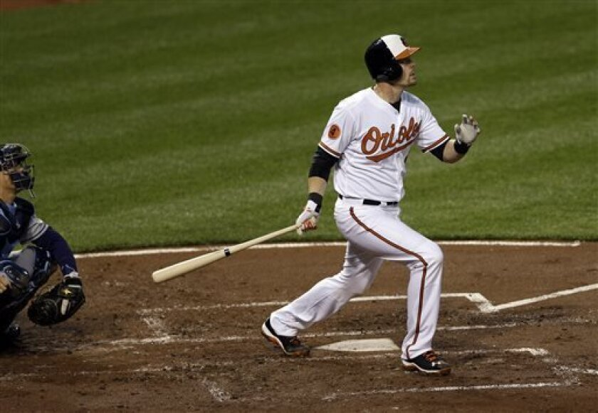 Baltimore Orioles' Matt Wieters watches his solo home run in the second inning of a baseball game against the Tampa Bay Rays on Tuesday, April 16, 2013, in Baltimore. (AP Photo/Patrick Semansky)
