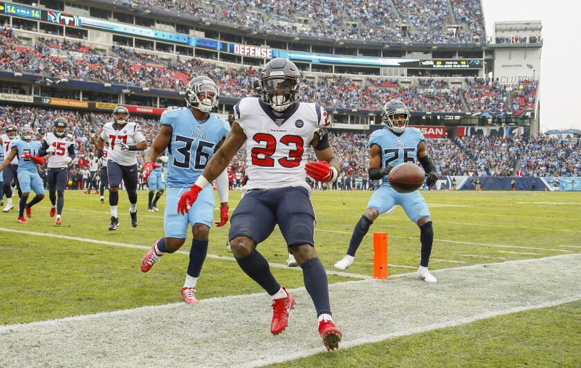 Texans running back Carlos Hyde scores a touchdown against the Titans on Sunday.