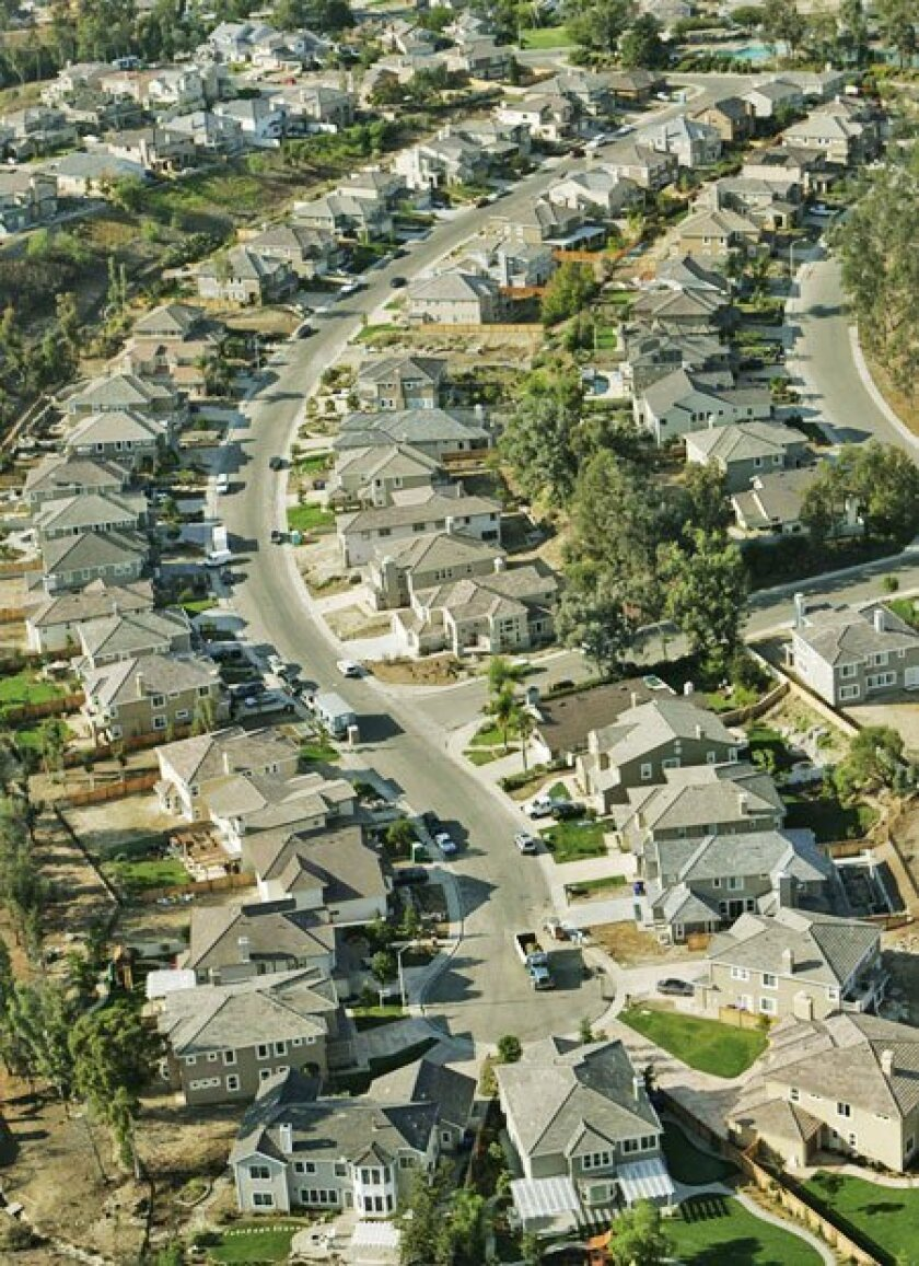 A Scripps Ranch street exemplifies the typical sprawling suburban land pattern. (John Gibbins / Union-Tribune)