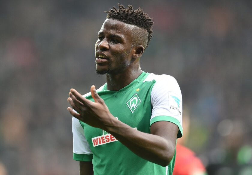 FILE - In this March 5, 2016 file picture Bremen's Papy Djilobodji is on his way to the dressing room during the German Bundesliga soccer match between Werder Bremen and Hannover 96 in Bremen. Werder Bremen defender Papy Djilobodji has been banned for two Bundesliga matches and fined for making a throat-slitting gesture during a match against Mainz 05 on Saturday March 19, 2016. Senegal international Djilobodji is on loan at Bremen from Chelsea. He will miss another match at the end of the ban because of accumulated yellow cards. ( Carmen Jaspersen/dpa via AP,file)