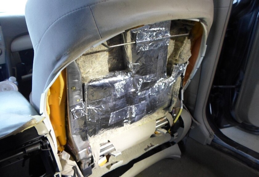 Border Patrol agents found 18 foil packages containing more than 46 pounds of cocaine and fentanyl hidden inside the seats of a car Wednesday on I-15 in Escondido.