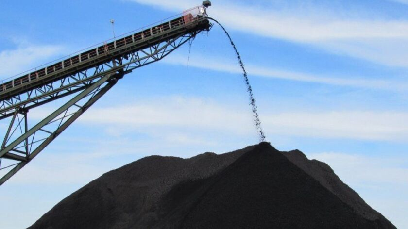 Coal produced at an underground mine in Muhlenberg County, Ky., is poured onto a pile used to load trucks in December 2018.