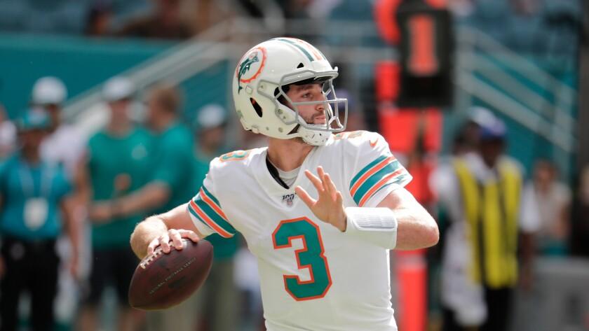 Dolphins quarterback Josh Rosen sets to throw the football.