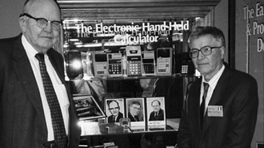 This 1997 photo taken by Phyllis Merryman shows Jack Kilby and Jerry Merryman, right, at the America