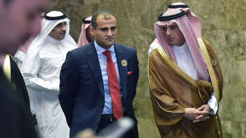 Saudi Foreign Minister Adel Jubeir, right, escorts Yemen's Deputy Foreign Minister Mohammed Hadrami as they arrive at a December meeting in Riyadh of seven Arab and African states surrounding the Red Sea.