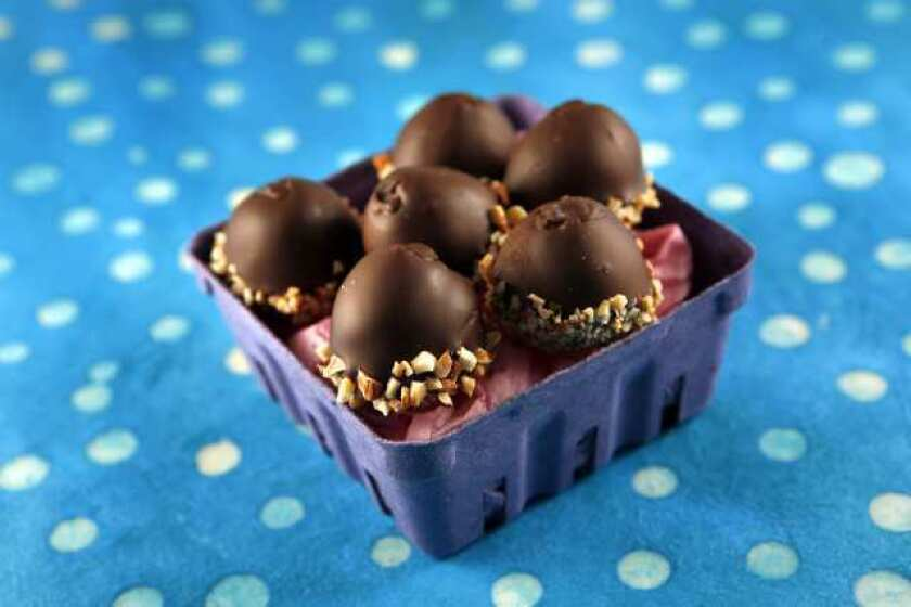 Chocolate-dipped almond eggs.