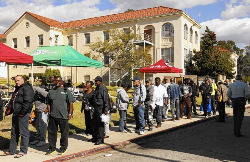 Veterans line up for lunch at West Los Angeles Veterans Affairs campus, where the VA held a stand-down to bring services and support to homeless veterans.