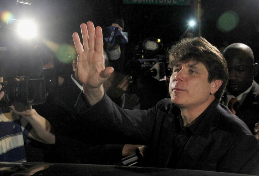 FILE - In this March 15, 2012 file photo, former Illinois Gov. Rod Blagojevich waves as he departs his Chicago home for Littleton, Colo., to begin his 14-year prison sentence on corruption charges. The 7th U.S. Circuit Court of Appeals in Chicago on Tuesday, July 21, 2015, tossed out some of Blagojevich's convictions that he sought to sell or trade President Barack Obama's old U.S. Senate seat. (AP Photo/Charles Rex Arbogast, File)