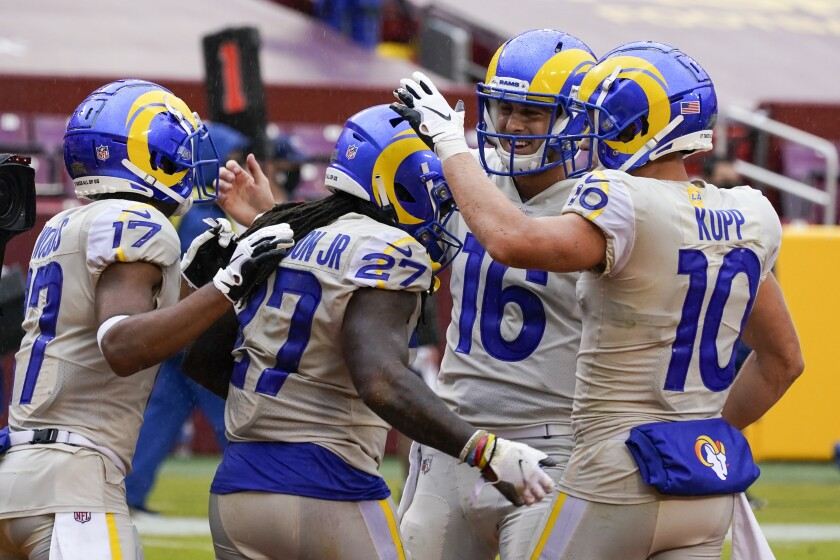 Rams' Darrell Henderson is congratulated after running for a touchdown.