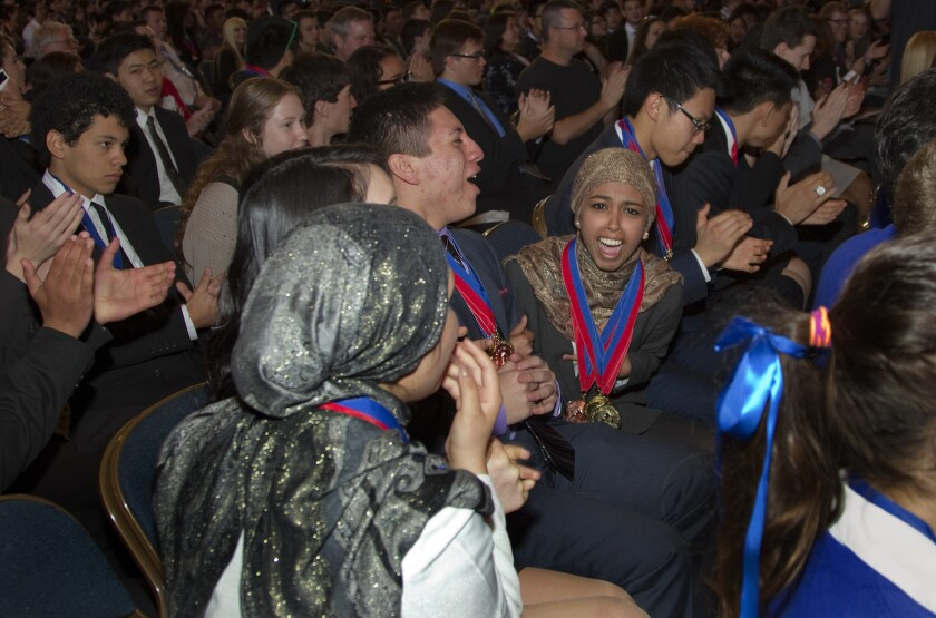El Camino Real Charter team members exult after winning the state Academic Decathlon at Memorial Auditorium in Sacramento.