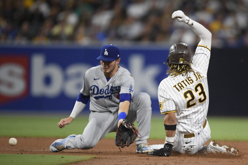 Padres' Fernando Tatis Jr. steals second base ahead of the throw to Dodgers' Gavin Lux at Petco Park on June 23.