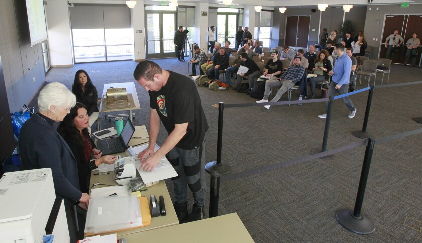 Paul Tossonian of Riverside County Dispensary and Delivery files a medical marijuana store application on Jan. 22 at the Vista Civic Center.