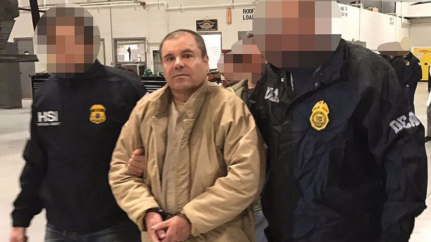 """Mexican police escort Joaquin """"El Chapo"""" Guzman in Ciudad Juarez in this undated photo as he is extradited to the United States."""
