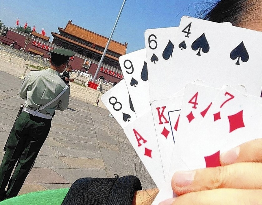Playing cards displayed at Tiananmen Square reference the date of the crackdown, June 4, 1989, and the AK-47 rifles used by Chinese authorities.