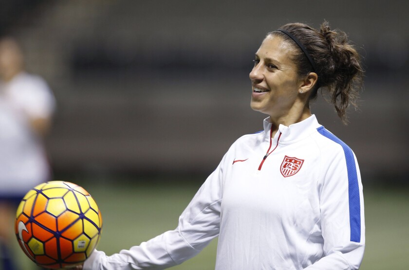 U.S. midfielder Carli Lloyd smiles during a practice session for the team's international soccer friendly against China in New Orleans on Dec. 15.