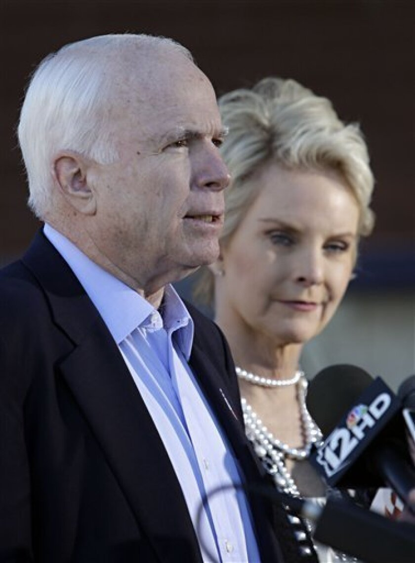 U.S. Sen. John McCain, R-Ariz., and his wife, Cindy McCain, speak to the media as they leave their polling station Tuesday, Nov. 2, 2010 in Phoenix. after casting their ballots. (AP Photo/Matt York)