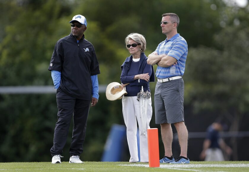 FILE-- In this July 29, 2014 file photo, Detroit Lions general manager Martin Mayhew, from left, owner and chairman, Martha Firestone Ford, and president Tom Lewand watch during NFL football training camp in Allen Park, Mich. The Lions fired Lewand and Mayhew Thursday, Nov. 5, 2015. Lewand was in h