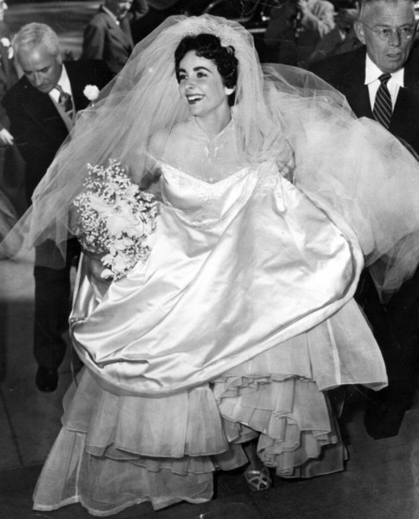 "Elizabeth Taylor enters the Church of the Good Shepherd in Beverly Hills for her first wedding, to Conrad ""Nick"" Hilton Jr."