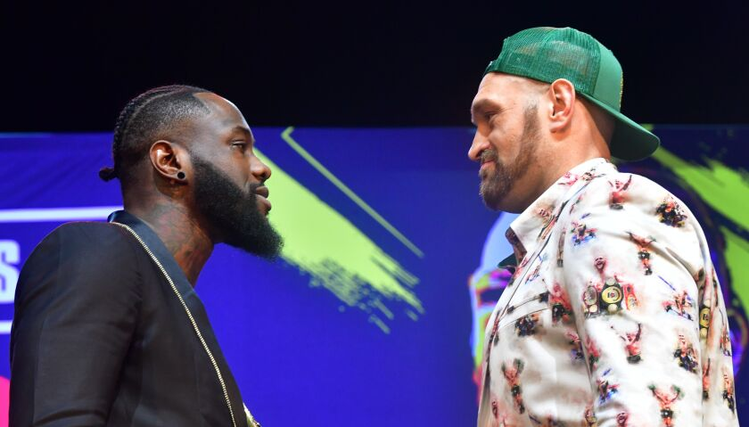 Boxers Deontay Wilder, left, and Tyson Fury face-off during a press conference in Los Angeles on Jan. 13 ahead of their re-match fight in Las Vegas on Feb. 22.
