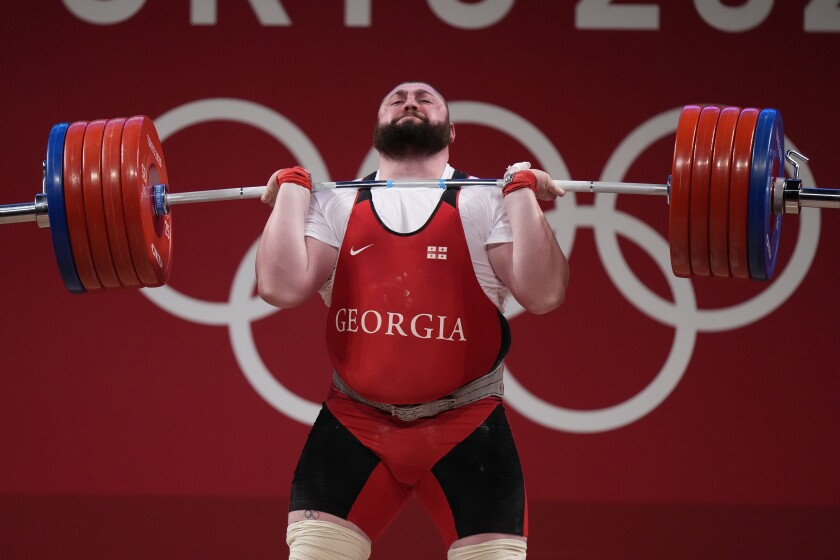 Lasha Talakhadze of Georgia competes in the men's +109kg weightlifting event, at the 2020 Summer Olympics, Wednesday, Aug. 4, 2021, in Tokyo, Japan. (AP Photo/Luca Bruno)