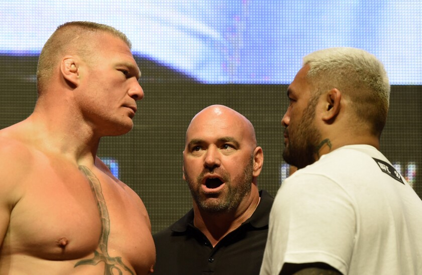 UFC President Dana White stands between fighters Brock Lesnar, left, and Mark Hunt during their weigh-in for UFC 200 on July 8.
