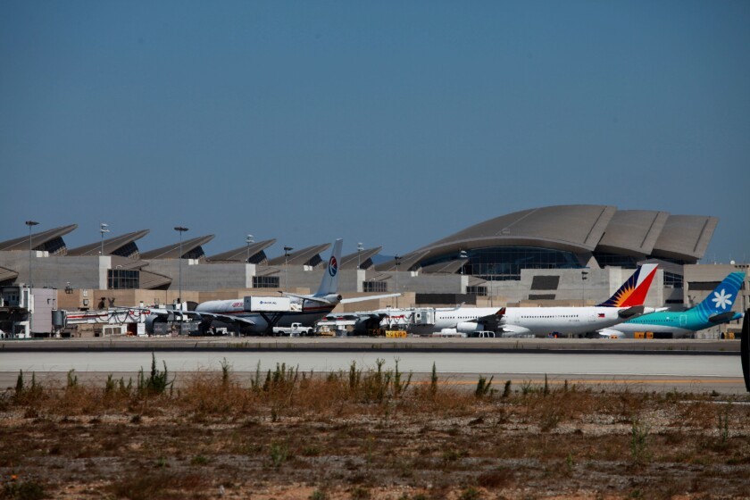 Aircraft line up along the west side of the new Tom Bradley International Terminal. A new passenger concourse with 11 gates will be completed nearby by 2020.