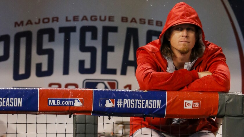 Angels pitcher Jered Weaver looks on from the dugout during the team's season-ending loss to the Kansas City Royals on Sunday.