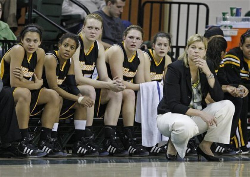 Milwaukee head coach Sandy Botham and her team watches as Wisconsin-Green Bay scores during the second half of an NCAA college basketball game Saturday, Feb. 4, 2012, in Green Bay, Wis. Wisconsin-Green Bay won 85-39. (AP Photo/Matt Ludtke)