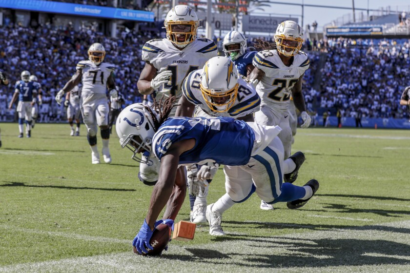 Indianapolis Colts receiver TY Hilton dives for a touchdown past Chargers defenders late in the fourth quarter at Dignity Health Sports Park on Sunday.