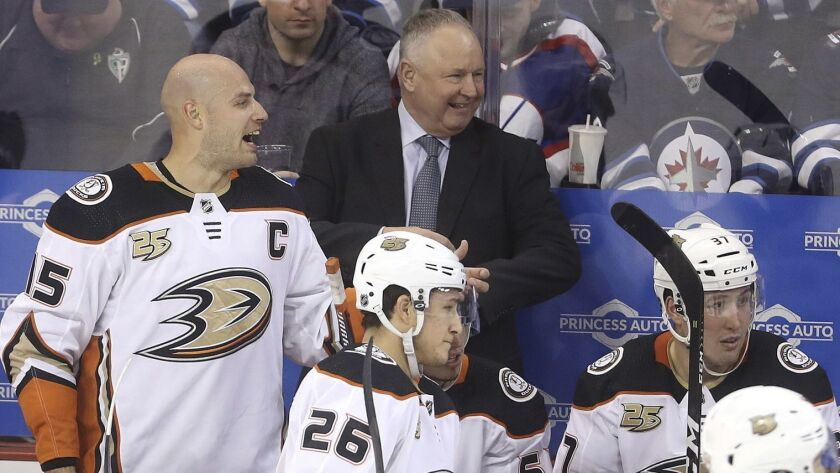 Anaheim Ducks' Ryan Getzlaf (15), standing next to head coach Randy Carlyle, yells during the third