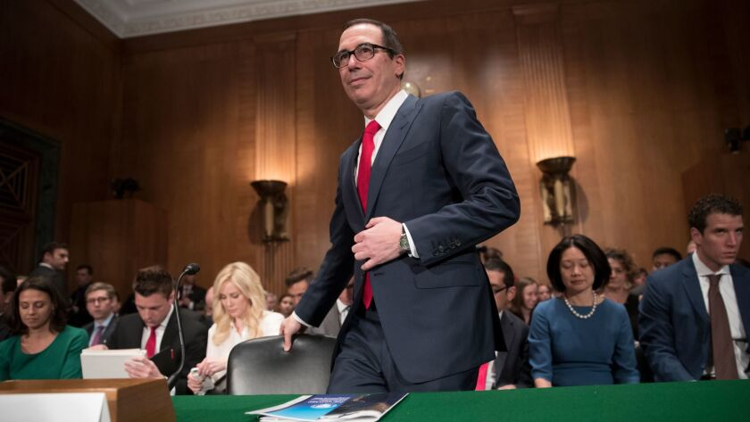 Treasury Secretary Steven Mnuchin arrives on Capitol Hill in Washington, Thursday, May 18, 2017, to