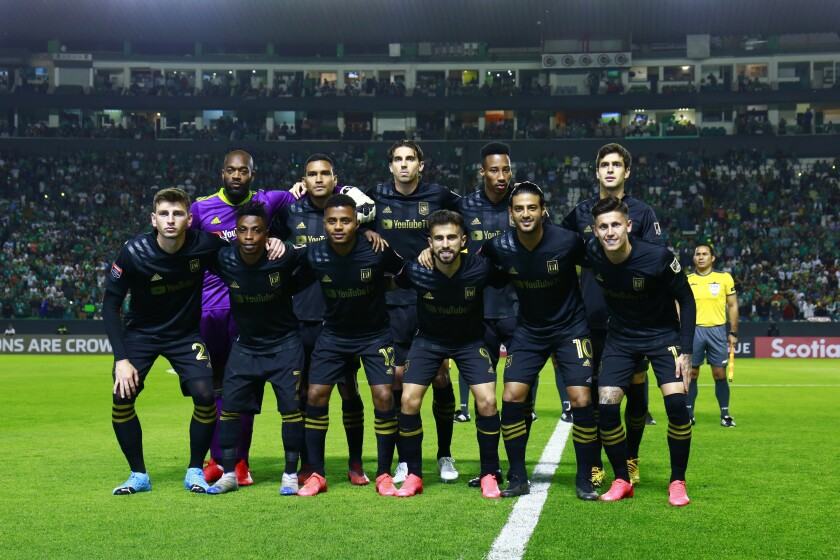 LAFC players pose before their CONCACAF Champions League match against León on Tuesday.