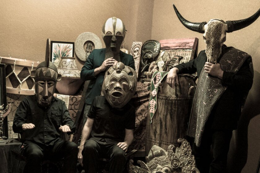 Masked men: Skerik, left, Evan Flory Barnes (Back), Andy Coe (Front) and Barrett Martin.