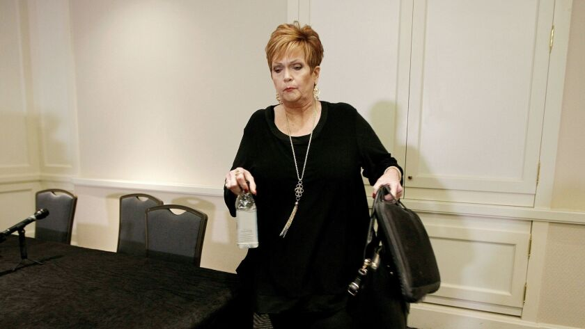 Beverly Young Nelson leaves a news conference on Dec. 8, 2017, in Atlanta after presenting evidence that Alabama U.S. Senate candidate Roy Moore signed her yearbook.
