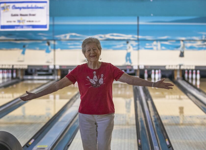 Lillian Solomon, who is turning 100 on Sept. 18, celebrates getting a strike for her team.